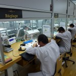 ... watchmakers are regulating movements before they are incased ...