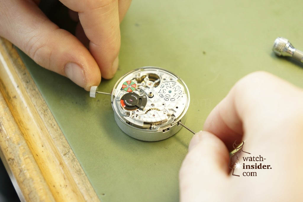 "… a watchmaker was assembling an testing the ""Doublematic"" …"