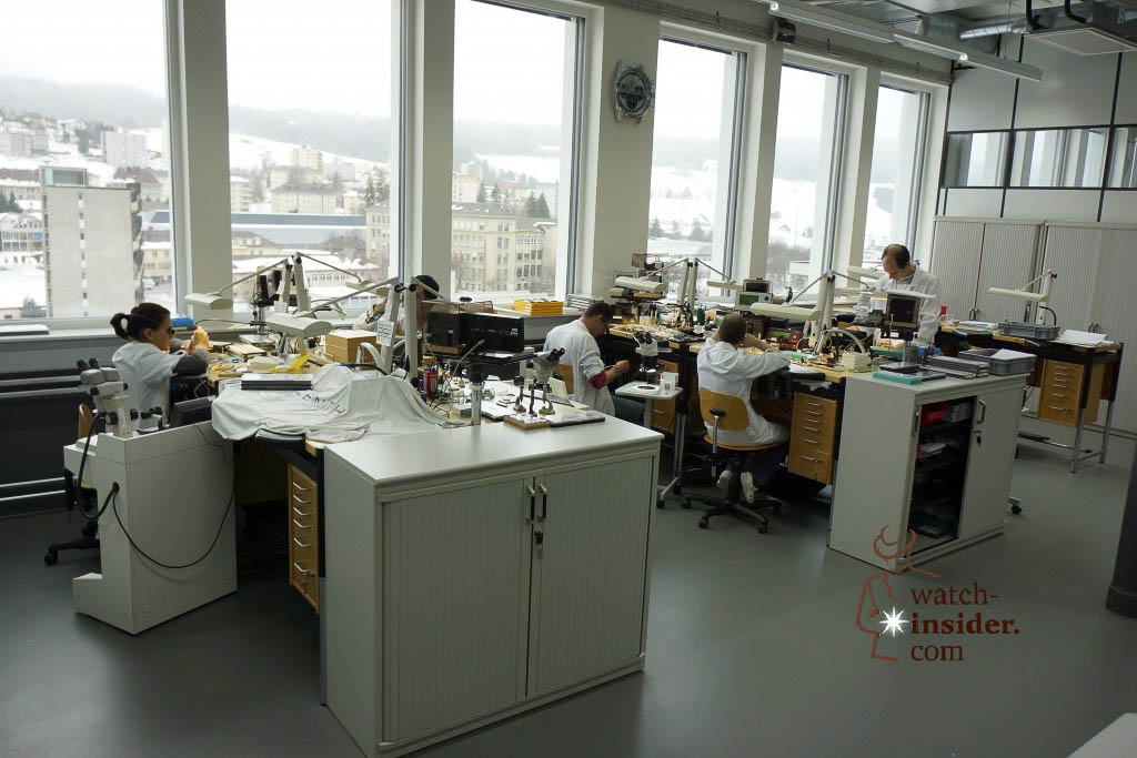 … ladies and gentlemen: The master watchmakers in their workshop in Le Locle …